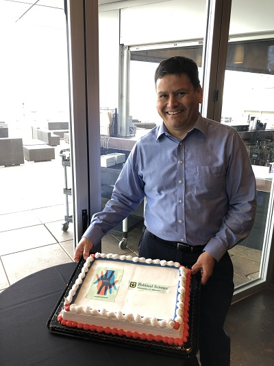 Moises Arce and book cover cake