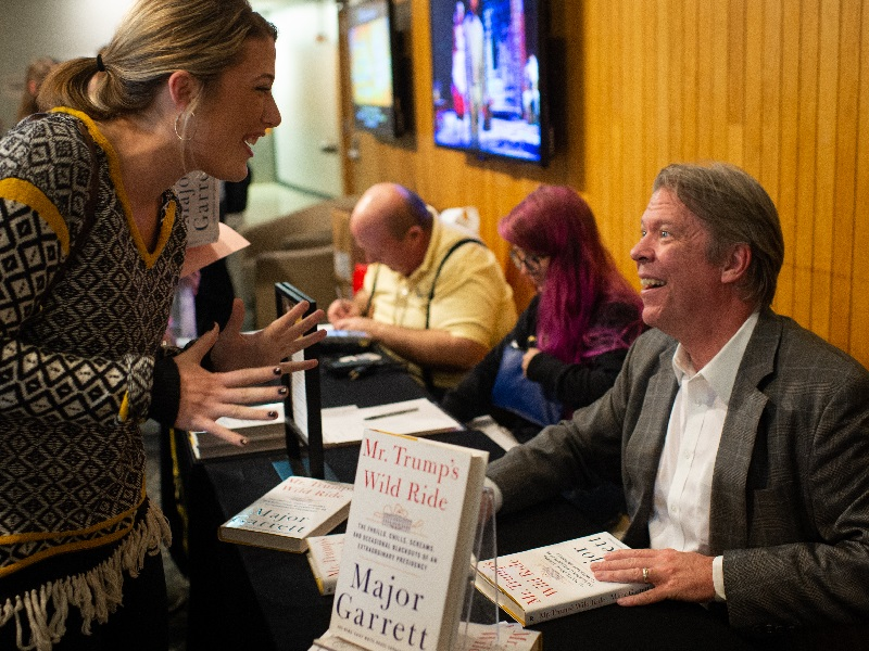 Major Garrett signs book