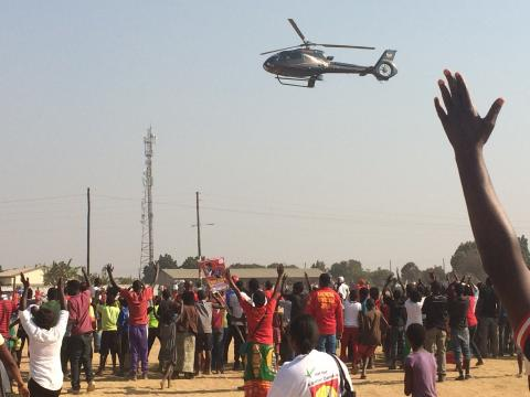 Opposition presidential candidate, Hakainde Hichilema, arrives by helicopter at campaign rally in Ndola, Zambia